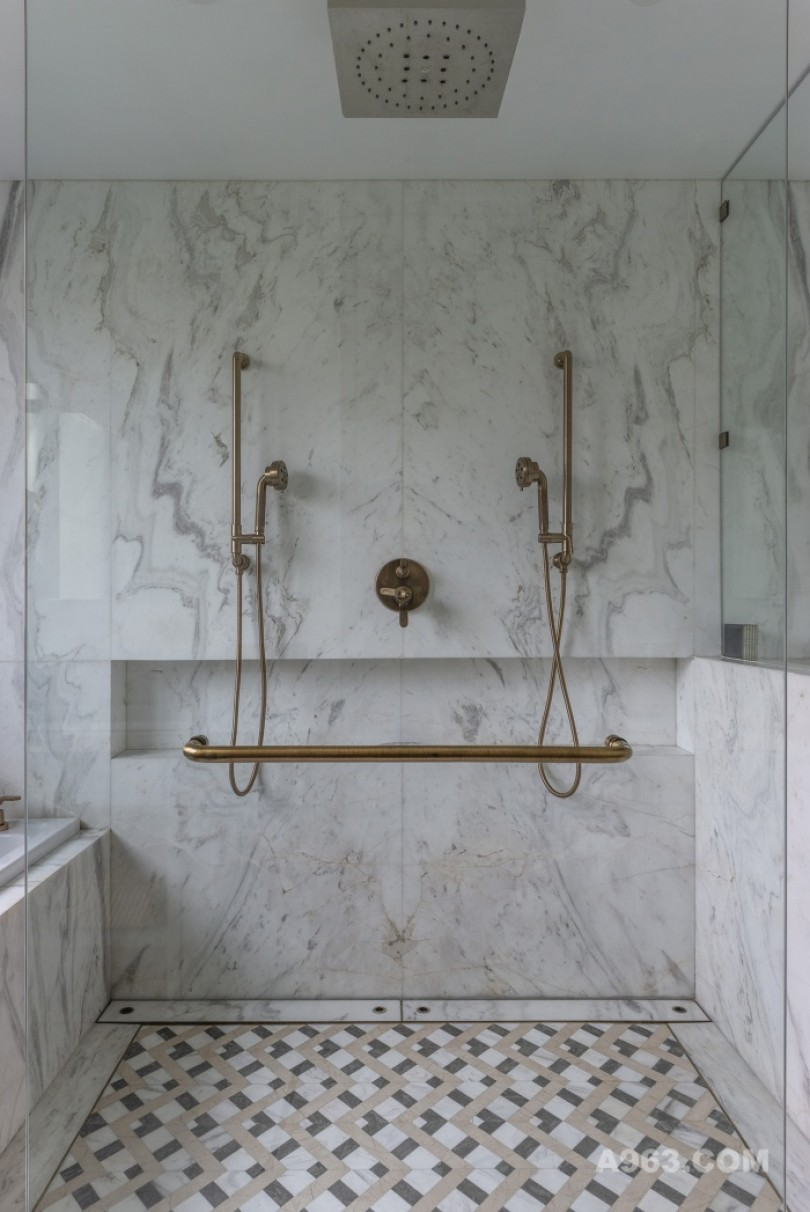 Master Bathroom clad in white marble and finished with brass fittings