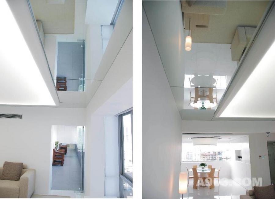 客厅 深居闹市可独享清静,简单自然而舒适贴心。这是居者希望的生活状态。  以极简的设计手法改变原建筑空间后发掘它简单实用的空间本质。设计规划的五大设备系统(1水家装系统、2新风系统、3除尘垃圾处理系统、4中央空调系统、5智能化系统)以及大量种类繁多的家居用品暗藏在简约的建筑皮肤内,与环境有机地融为一体,实现了复杂的公寓建筑和日常生活的基本功能需求。(人与建筑的形体和谐)  现代极简的建筑空间作为载体,融和老子【道法自然】思想,创造安宁平静、健康自然的生活空间,回归人性本质生活。无欲而心静,宁静而致远。(人与自然的灵魂和谐)  设计之道,道法自然。设计改变生活,生活回归自然。  08鲍鱼/南宁