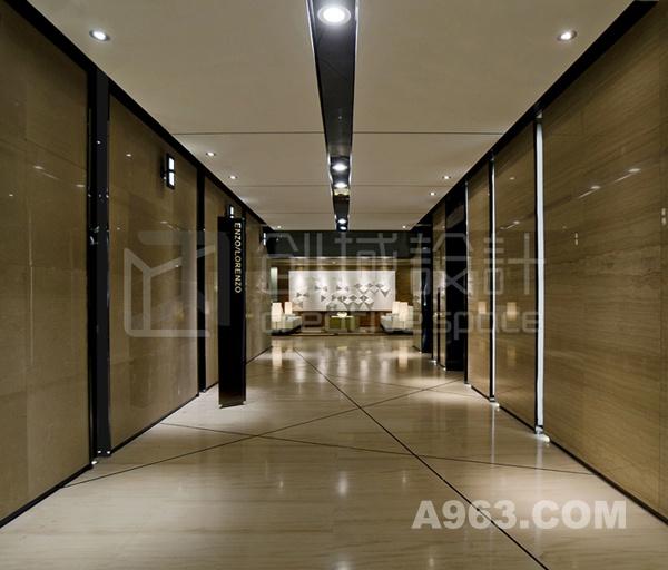 入户电梯 入户电梯间着重分析空间体块关系并利用斜向切割手法的设计打破常规,营造出一个低调时尚、沉稳而内敛的办公空间