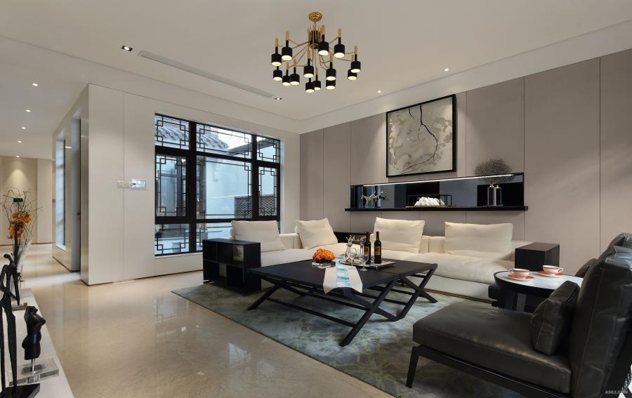 客厅-客厅的设计以简洁的米色为主调,黑白色的布艺沙发、图案独特的地毯,给整个空间增添了情趣