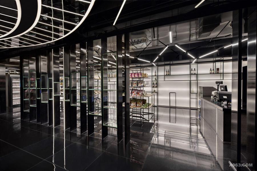 """大堂超市 超市的两个入口以""""圆盘""""服务台的圆心为基准左右对称,并且超市入口立面为""""音频""""的概念。"""