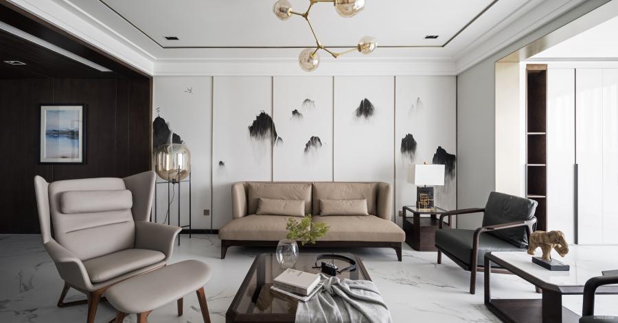 橡木色的沙发和深灰色的座椅搭配,沉稳又简单。木制大象,中式台灯,而最特别的莫过于墙上的泼墨画,设计师把中式和现代相结合,让业主觉得自己仿佛置身中国传统山水画中。