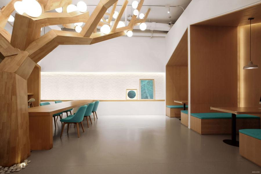"""大厅雕塑感极强的""""树""""是空间的核心,把大厅划分出""""吧台咨询、洽谈区、休息区""""等不同的空间功能。几何图形的""""房子""""搭配""""树""""的造型,让人回忆儿时的""""家""""。""""树""""的一侧是洽谈区与照片展示墙,功能和视觉层次更为丰富。"""