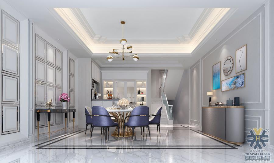从入户门进入室内空间,玄关与餐厅是连接在一起的,顶面的石膏线条与悬挂的金属吊灯,不会觉得很突兀,反而增加了艺术美感,简洁家具以及墙面的装饰画,美轮美奂。
