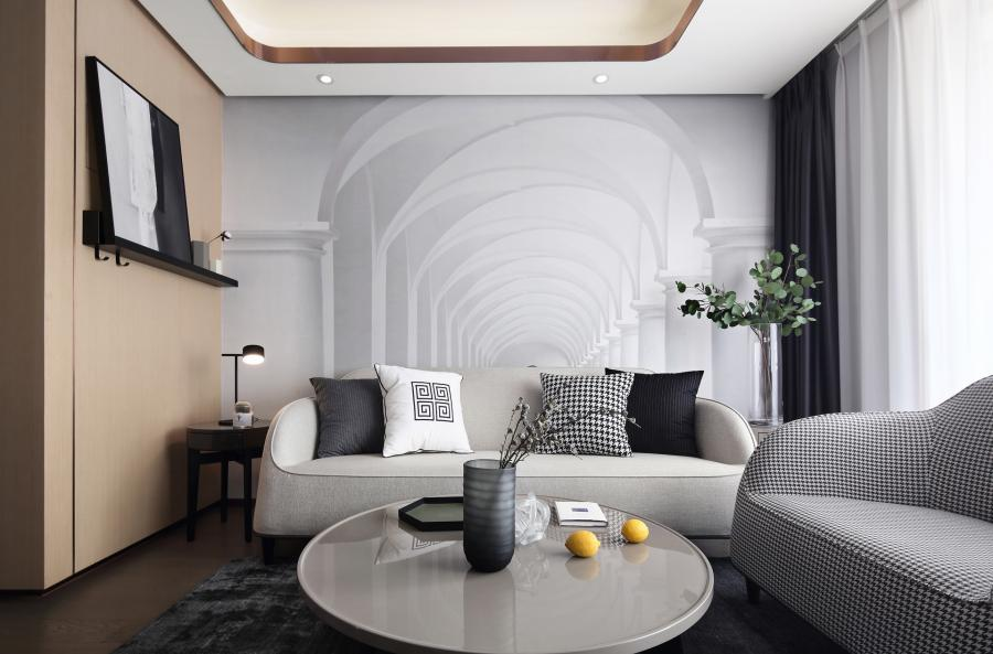 客厅的米白色三人沙发恬静沉稳,百看不厌;搭上千鸟格的单人沙发,极具艺术立体美感,整体感觉舒适,古朴自然。沙发背景墙定制了3D壁纸,在视觉上增加了空间的立体感。
