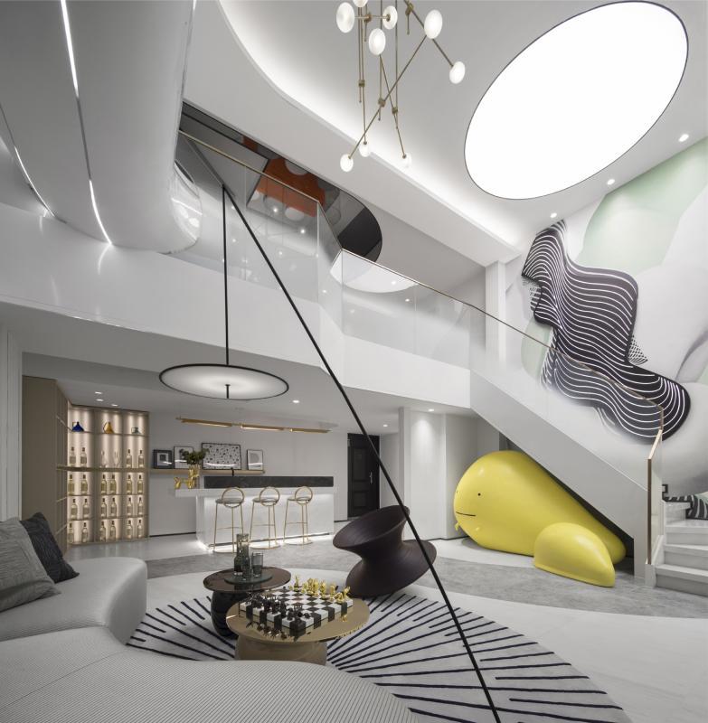 设计之初,大家有很多的构想,最终以「艺术」与「家」的概念来作为切入点来设计。进入客厅映入眼帘的是一幅现代人艺术与生活交织的画面。 进入客厅映入眼帘的是一幅现代人艺术与生活交织的画面。