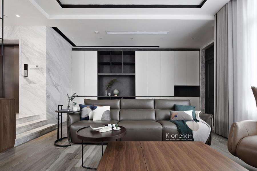 沙发背景墙采用柜体的设计,将整个墙面充分利用起来,减轻了不少地面储物的压力。
